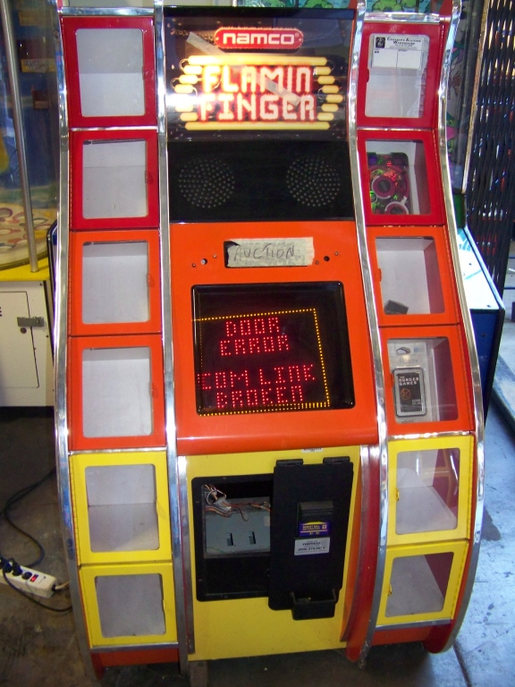 Lot 24 - FLAMIN FINGER PRIZE REDEMPTION GAME NAMCO N Item is in used condition. Evidence of wear and