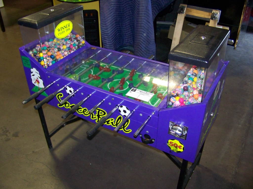 Lot 11 - SOCCER BALL FOOSBALL BULK VENDING MACHINE OK MFG. Item is in used condition. Evidence of wear and