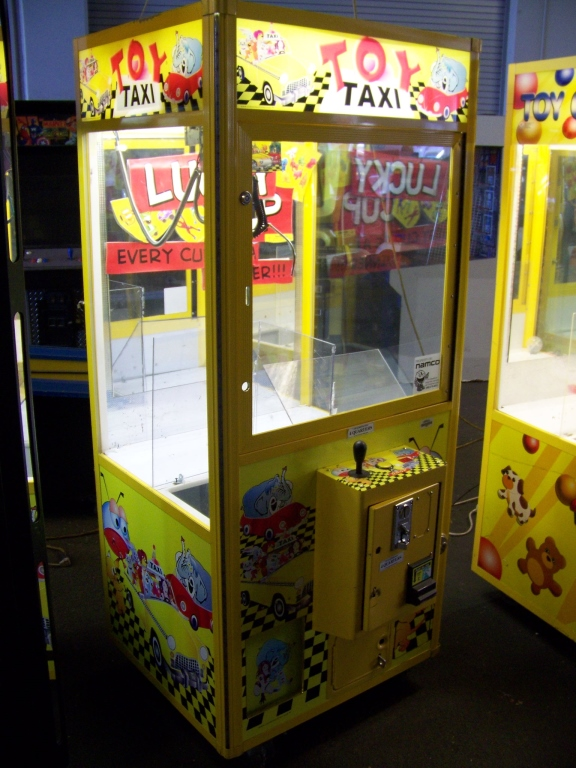 """Lot 37 - 30"""""""" TOY TAXI PLUSH CLAW CRANE MACHINE Item is in used condition. Evidence of wear and commercial"""