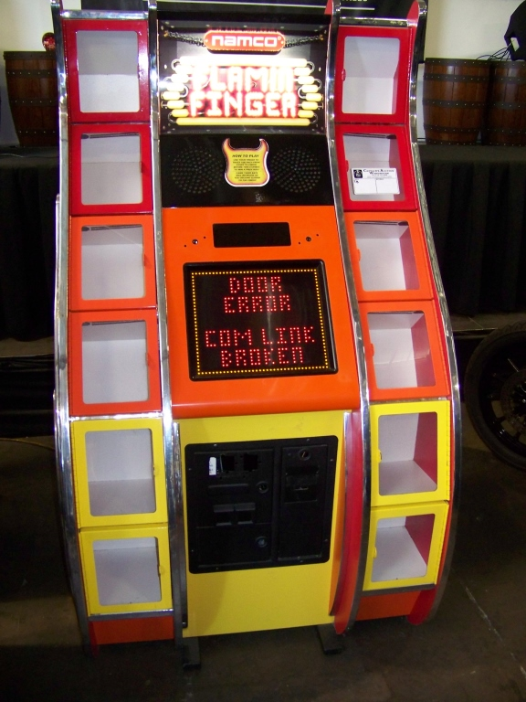 Lot 54 - FLAMIN FINGER PRIZE REDEMPTION GAME NAMCO TB Item is in used condition. Evidence of wear and