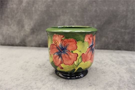 Moorcroft Hibiscus Jardiniere, of form to pattern on green