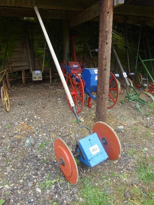 Lot 863 - Single row long pole hand drill on wooden wheels