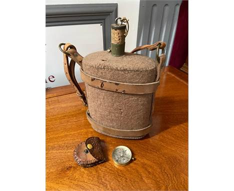 A Military style water flask with leather straps and original cork together with a vintage compass and small case.