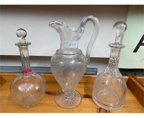 A 19th century etched claret wine jug, Facet cut decanter with stopper and one other