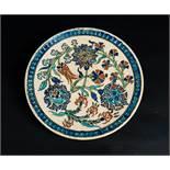 Arte Islamica A rimless pottery Iznik style dish Europe, possibly France, 19th century .