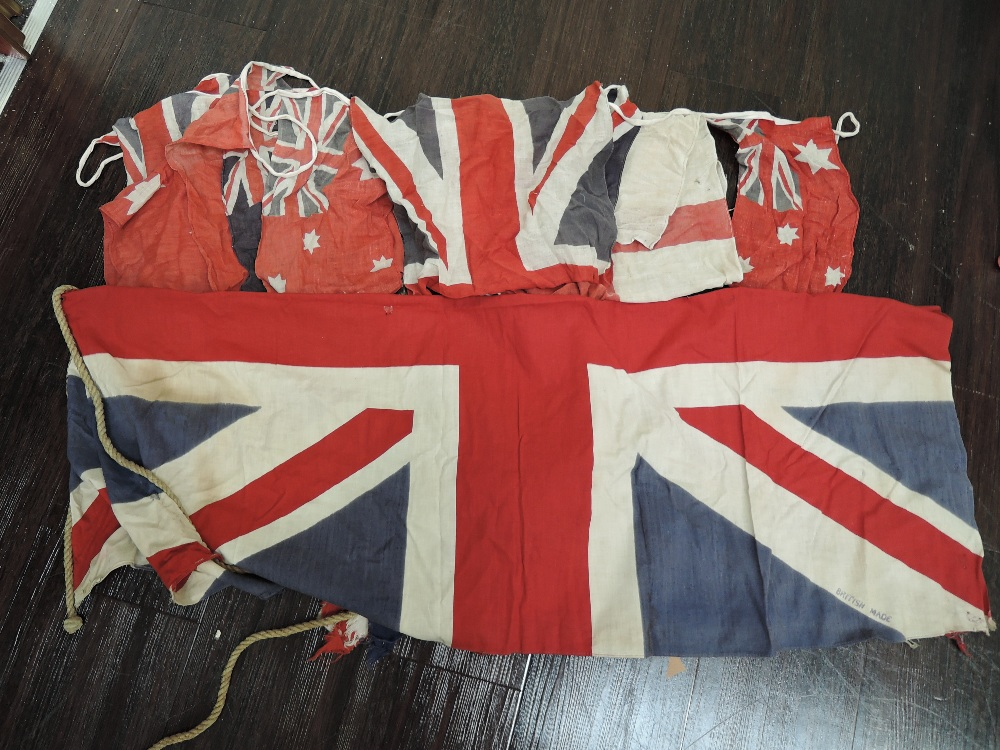 Lot 12 - A selection of vintage common wealth and British flags and bunting