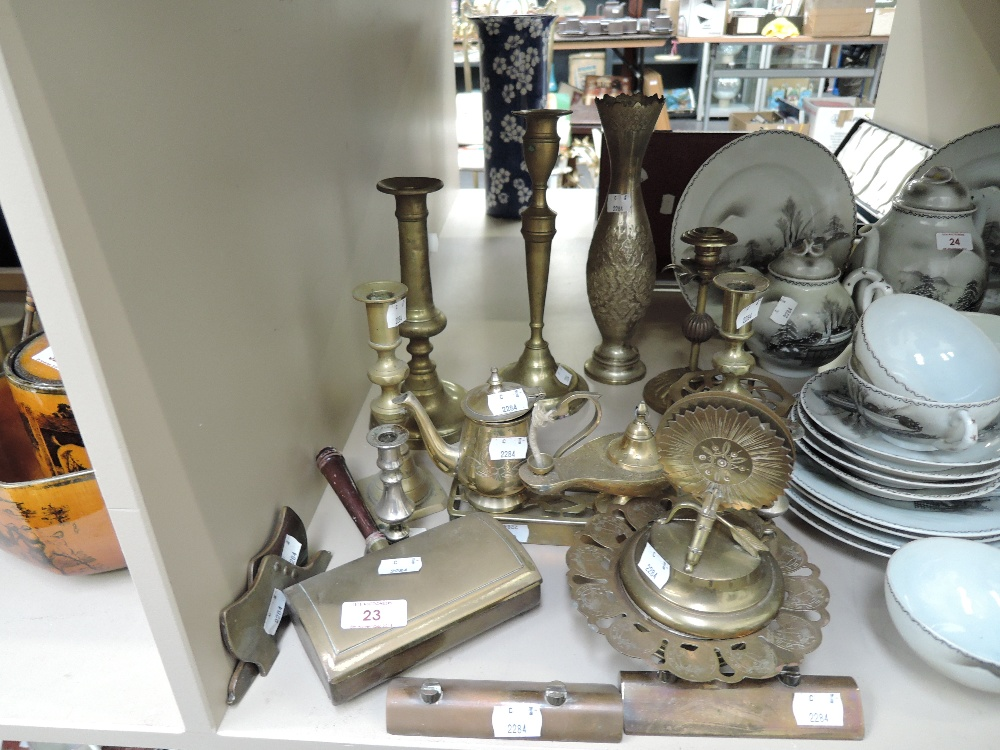 Lot 23 - A selection of vintage brass wares including candle sticks