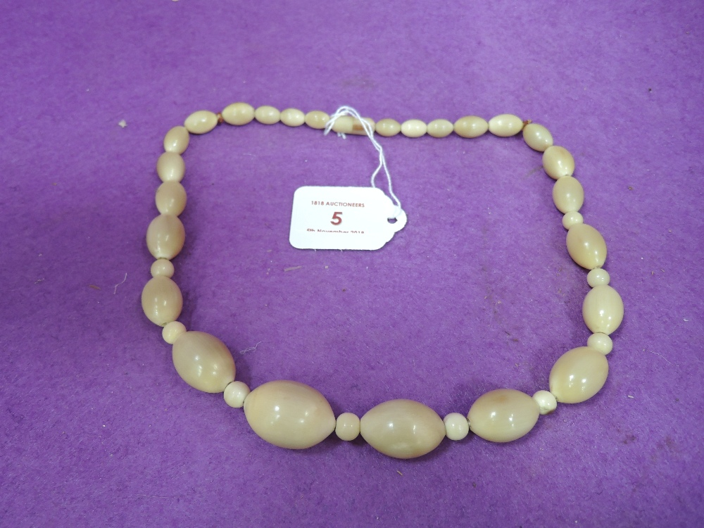 Lot 5 - A vintage ladies dress necklace possibley made from bone or horn