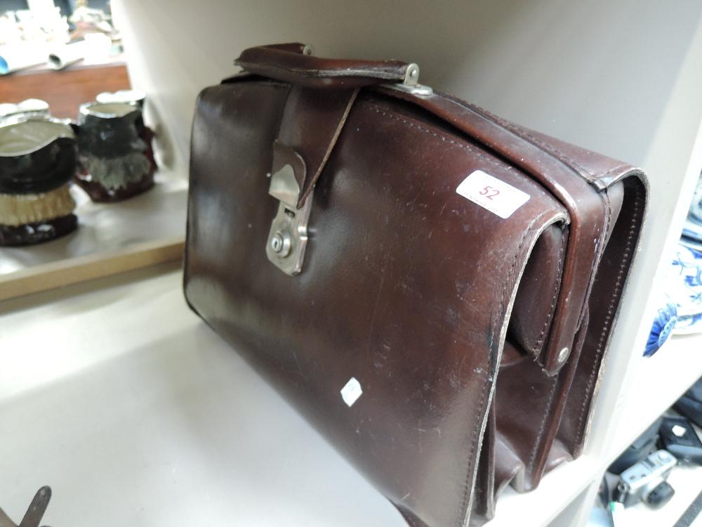 Lot 52 - A vintage brown leather bound satchel bag
