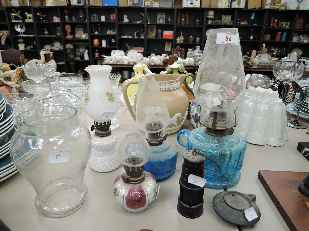 Lot 56 - A selection of vintage colour glass small size oil burning lamps