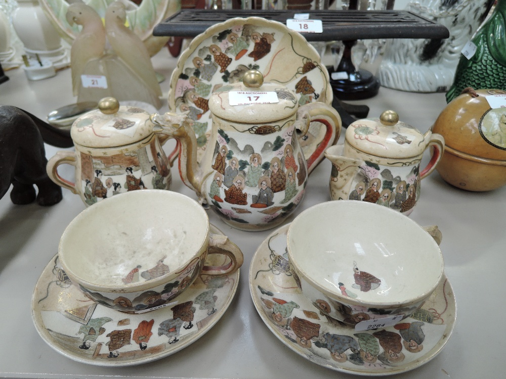 Lot 17 - A vintage ceramic tea set for two Japanese Satsuma ware hand decorated