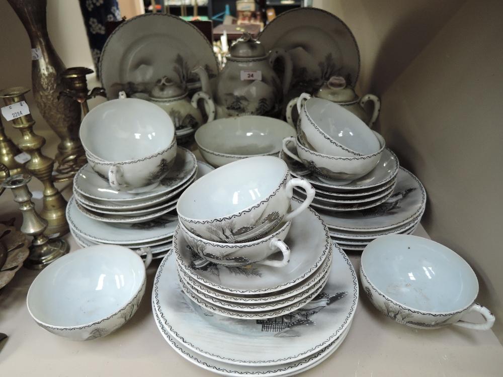 Lot 24 - A vintage hand decorated egg shell tea set