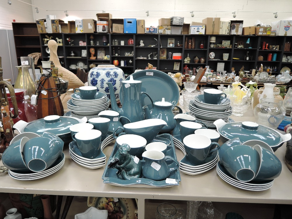 Lot 57 - A large part dinner tea coffee service by Pool pottery in a teal two tone design