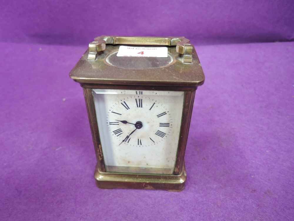 Lot 4 - A vintage carriage clock bevel edged glass brass body