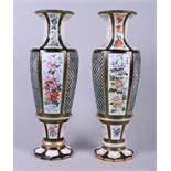 A pair of late 19th century Continental green and white overlaid cut glass vases with floral