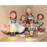 "Five Hummel figures of children, tallest 7 1/2"" high, in various poses (damages)"