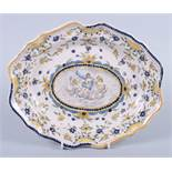 "A 19th century faience shaped edge dish with floral and classical figure decoration, 11 1/2"" wide"