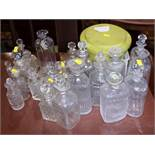A large collection of cut glass decanters, perfume bottles and stoppers