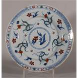 "An 18th century Bristol delft plate with polychrome floral decoration, 8 3/8"" dia (stabilised crack)"