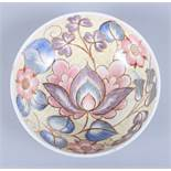 "A Midwinter bowl, designed by Nancy Great-Rex, decorated in a floral pattern, 8"" wide"