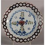 "An 18th century Lambeth delft plate with geometric and leaf decoration, 9"" dia (restored rim) c1750"