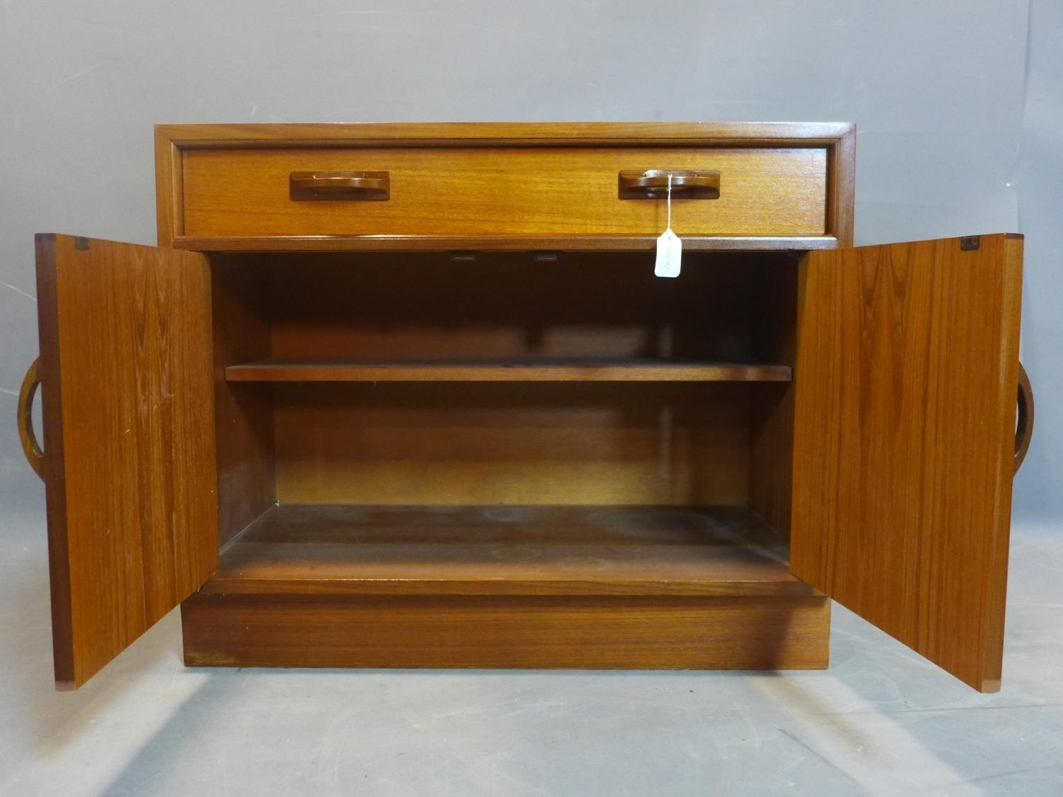 A G-plan teak cabinet, with one long drawer above two cupboard doors, on pedestal base, label to - Image 3 of 3