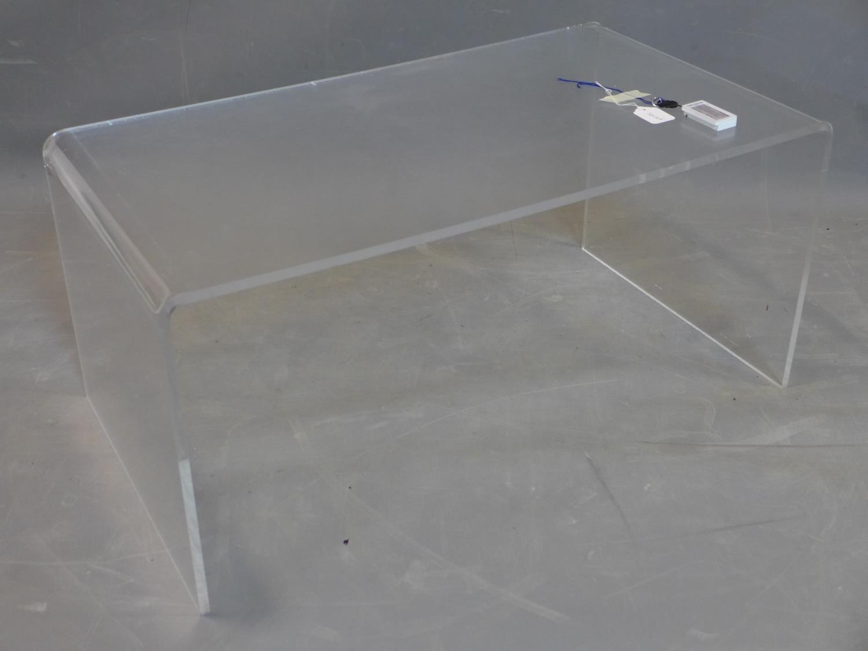 Lot 79 - A perspex table, H.40 W.90 D.50cm