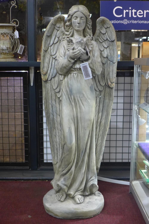 Lot 46 - A cast plaster angel holding a bird, H.121cm