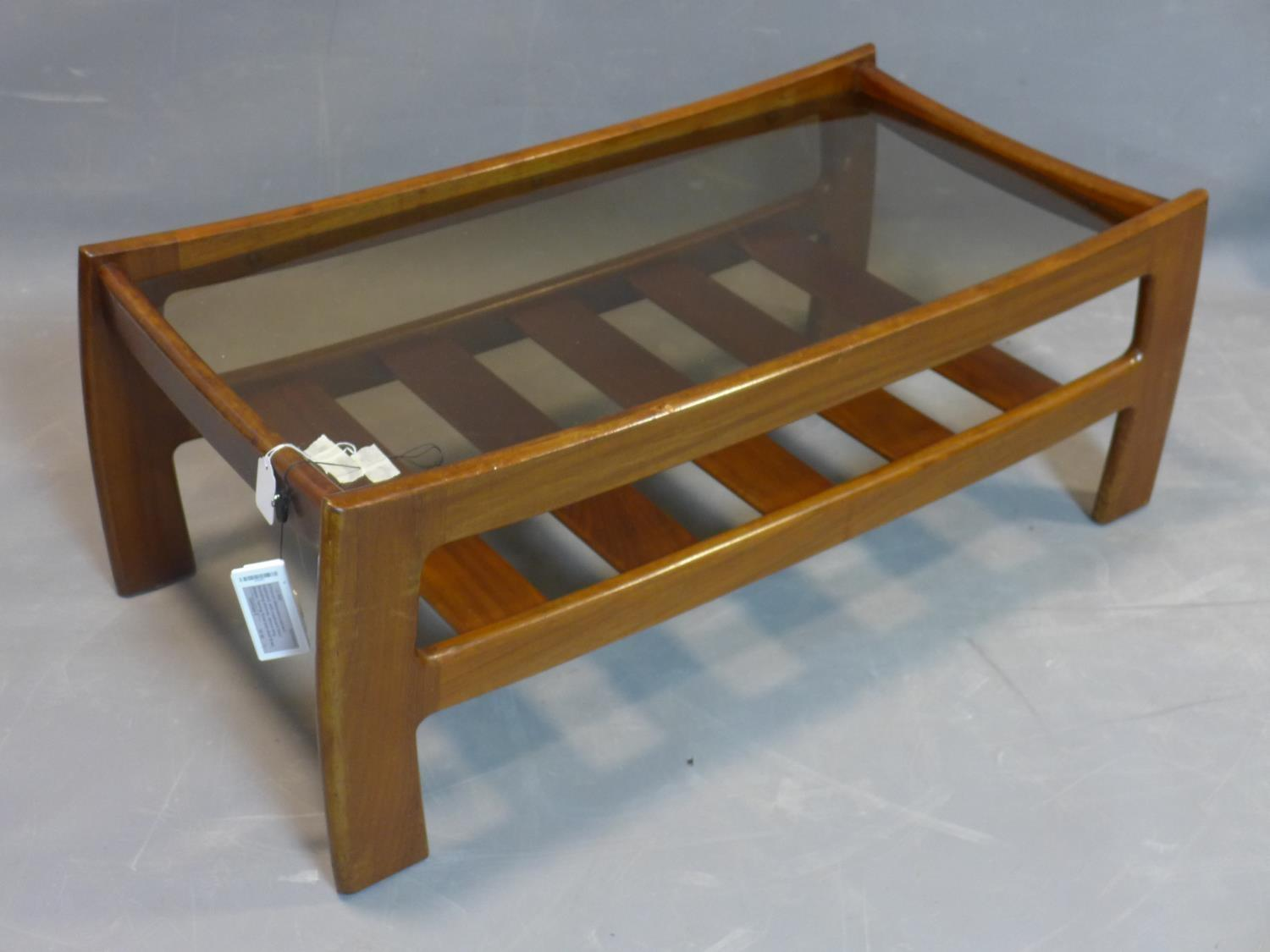 A mid 20th century teak coffee table, with glass top above undertier rack, H.40 W.105 D.53cm - Image 2 of 2