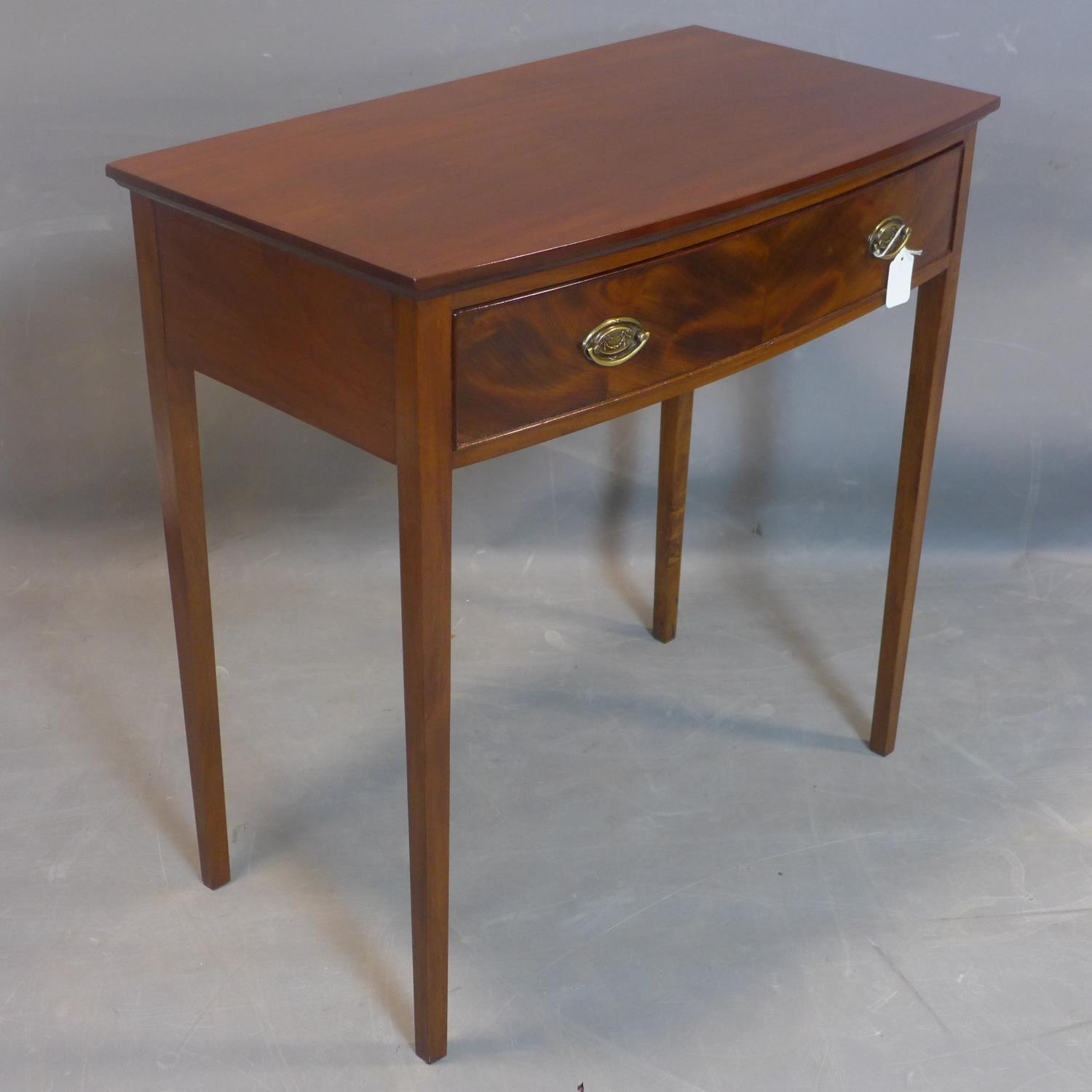 Lot 118 - A 19th century mahogany bow fronted side table, with single drawer, on square tapered legs, H.76 W.
