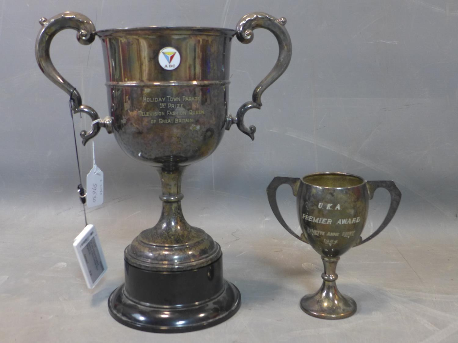 Lot 106 - A large twin handle silver plated trophy for 'Holiday Town Parade 1st Price Television Fashion Queen