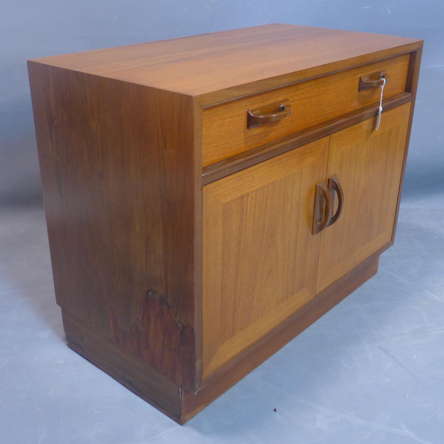 A G-plan teak cabinet, with one long drawer above two cupboard doors, on pedestal base, label to - Image 2 of 3