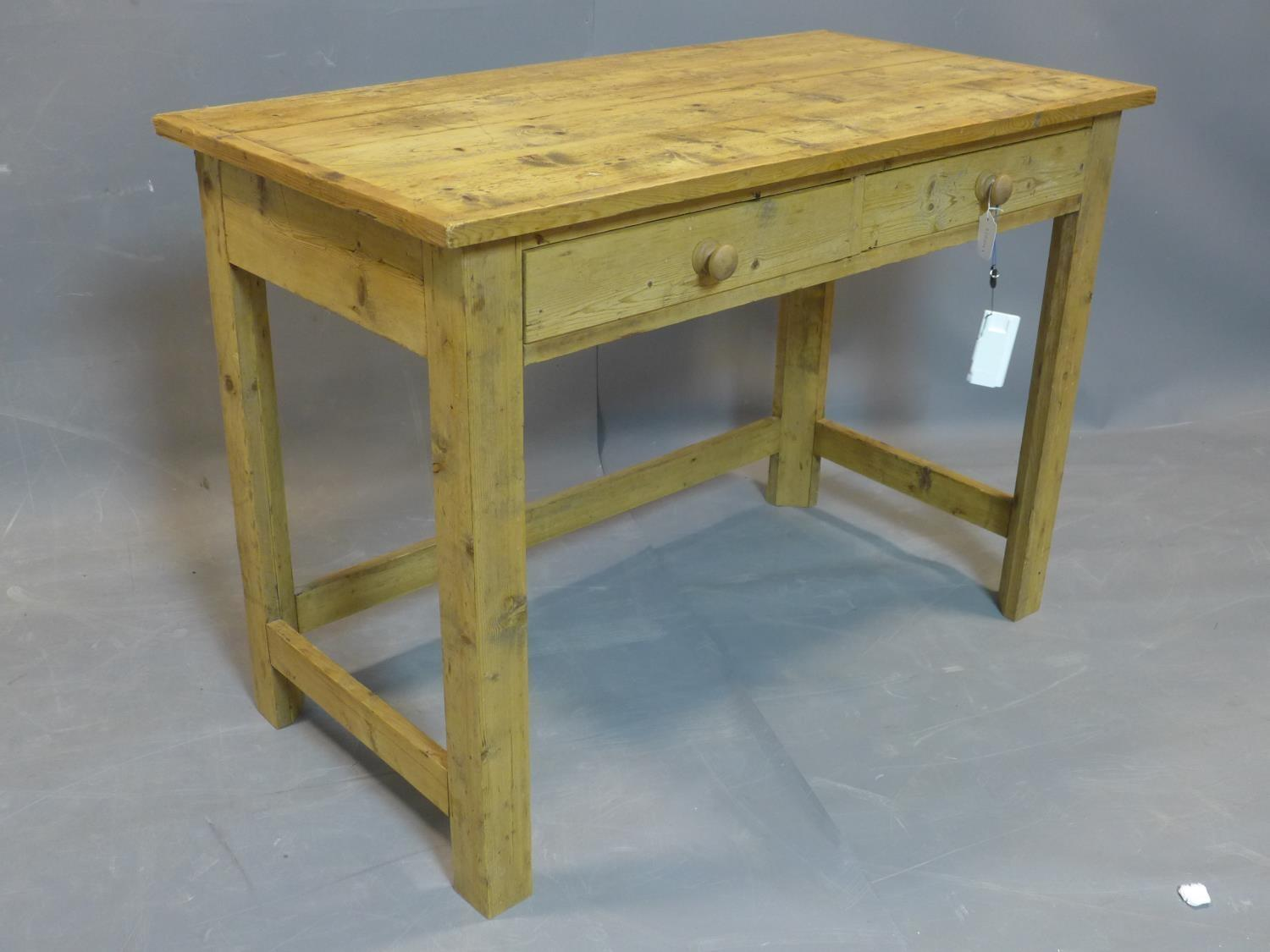 Lot 74 - A 20th century pine table, with two drawers, raised on square legs joined by stretcher, H.76 W.107
