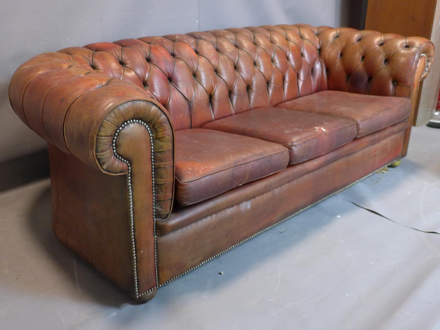 A three seater leather Chesterfield sofa, with button back upholstery, heavily worn - Image 2 of 3