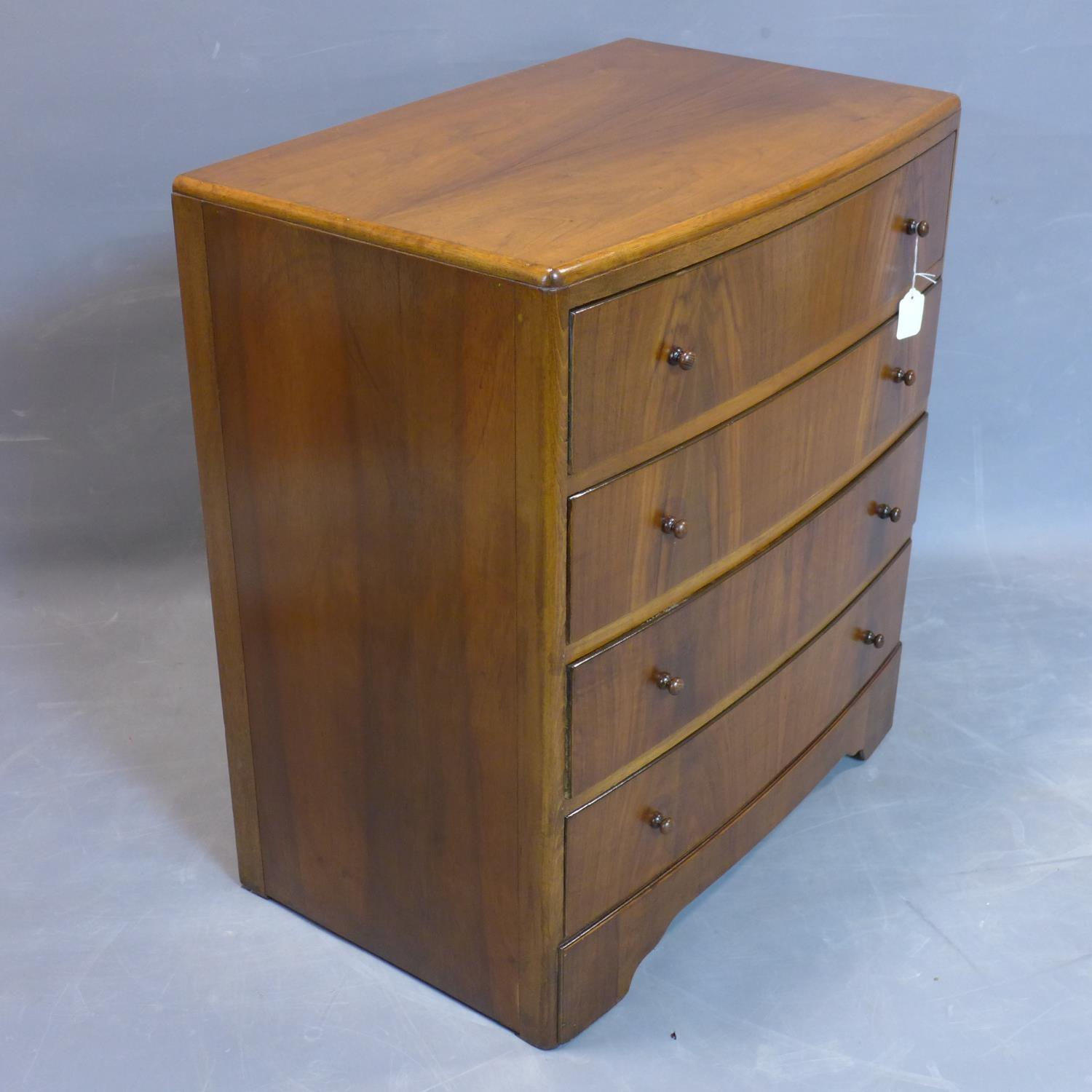 Lot 121 - A walnut bowfronted chest of four drawers, on bracket feet, H.85 W.76 D.48cm