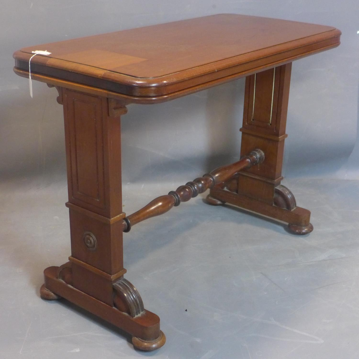 A 19th century mahogany three tier metamorphic buffet, on carved supports joined by turned