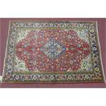 A central persian Qum Rug 200cmx140, central double pendant medalion, with repeat floral motifs, and