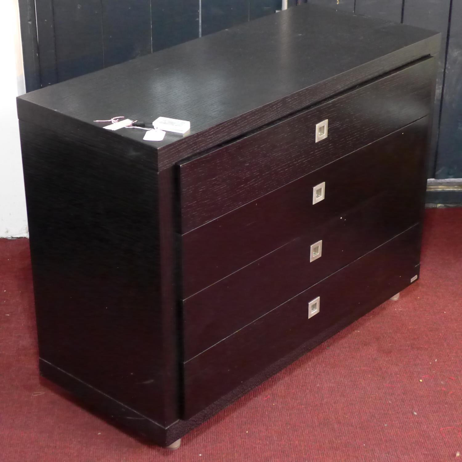 Lot 266 - A Dwell stained oak chest of 4 drawers, H.75 W.100 D.43cm