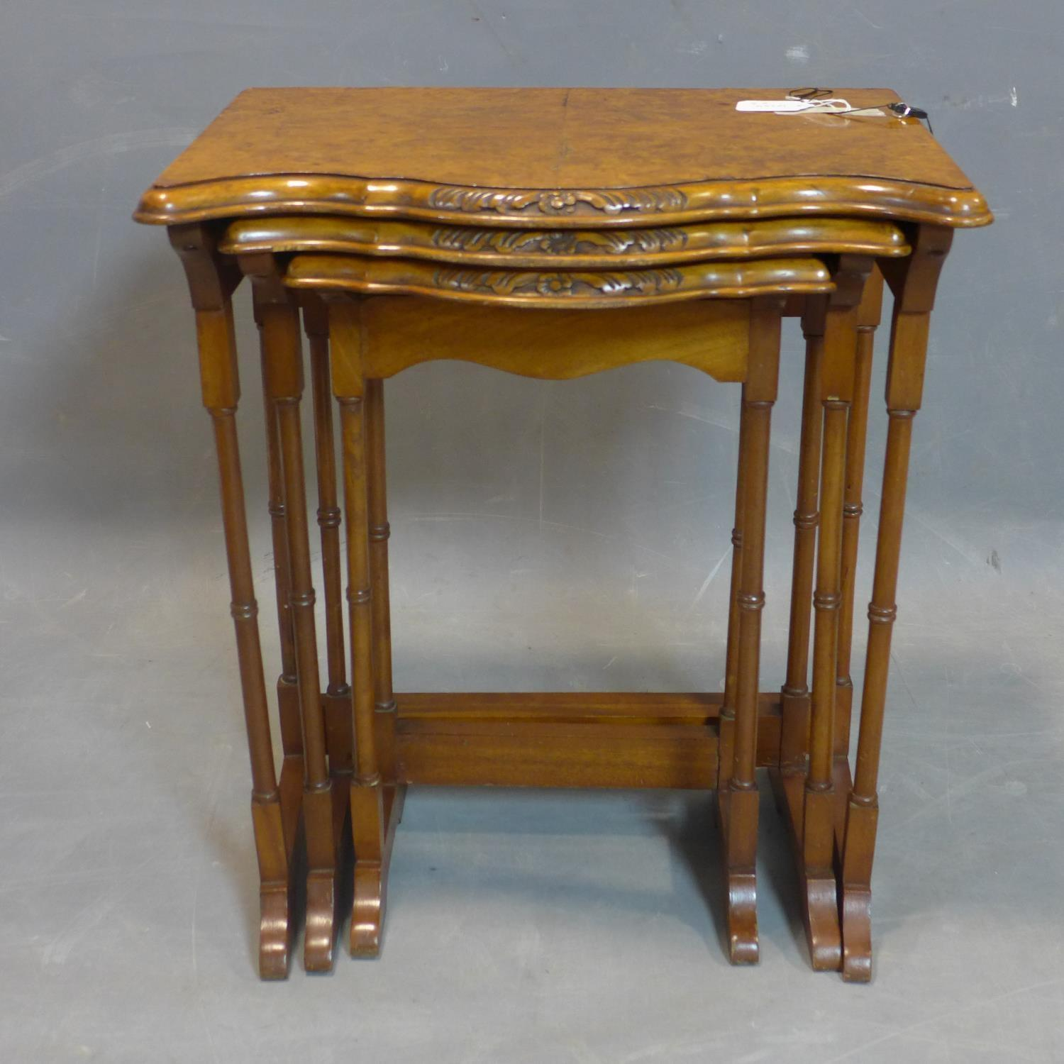 A walnut nest of three tables, with quarter veneered tops with serpentine fronts, raised on - Image 2 of 2