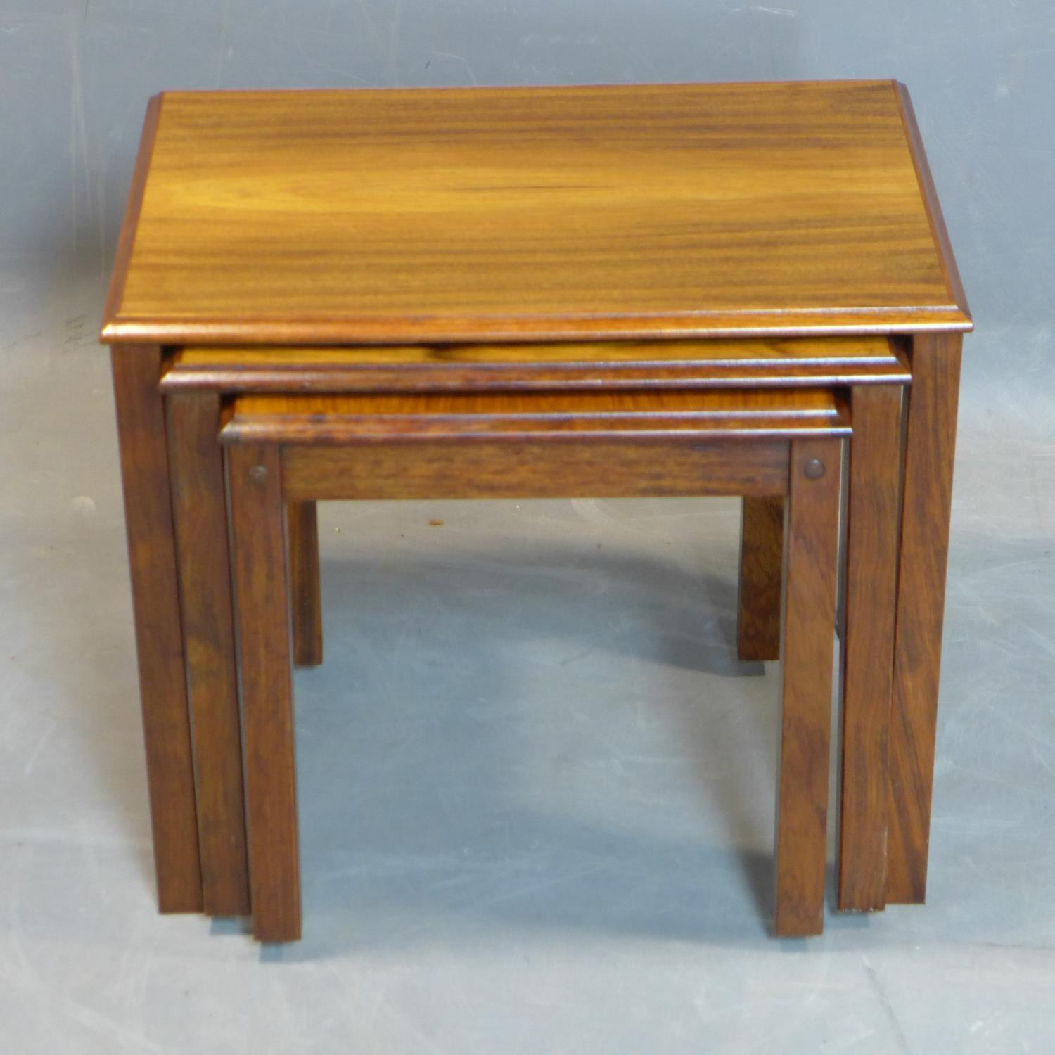 A nest of three Danish exotic hardwood tables, marked 'Made in Denmark' to bases, H.46 W.54 D.39cm - Image 2 of 3