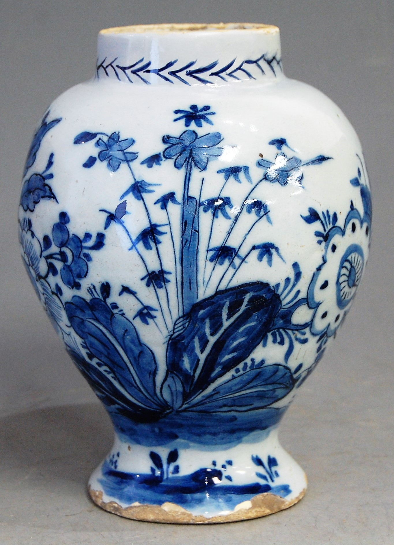 Lot 19 - An 18th century delft blue and white vase, of baluster form, h.18cm