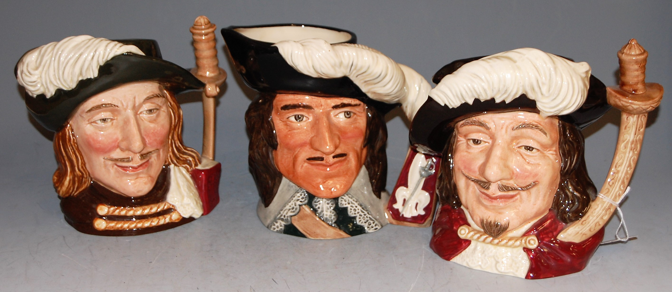 Lot 60 - Three Royal Doulton character jugs, being The Three Musketeers comprising Porthus D6440, D'