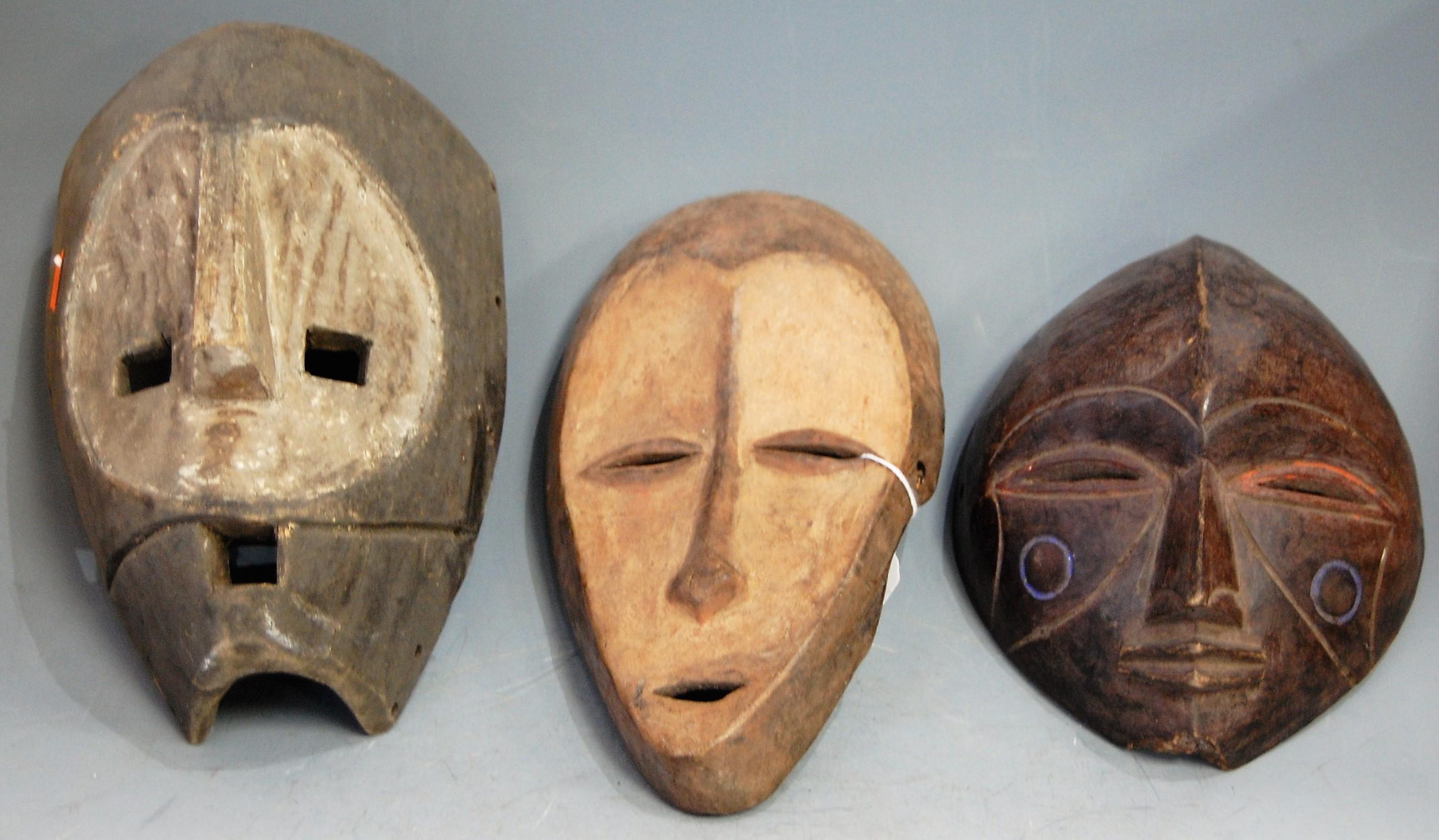 Lot 5 - Three mid-20th century African masks, to include Kumu (Democratic Republic of Congo), Lega (also