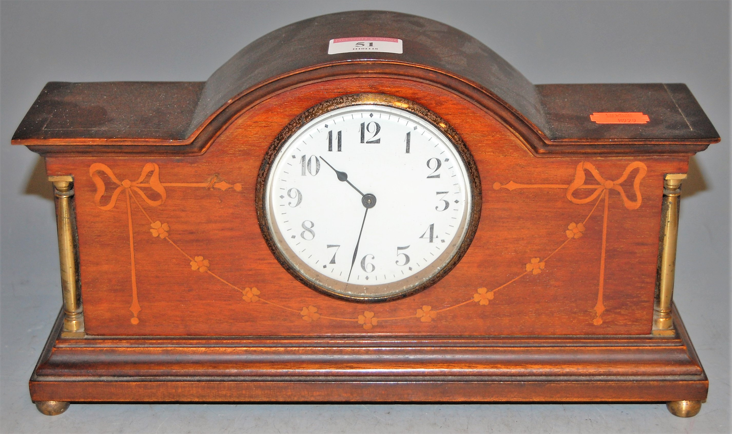 Lot 51 - An Edwardian mahogany and satinwood inlaid mantel clock, having enamelled dial with Arabic numerals,