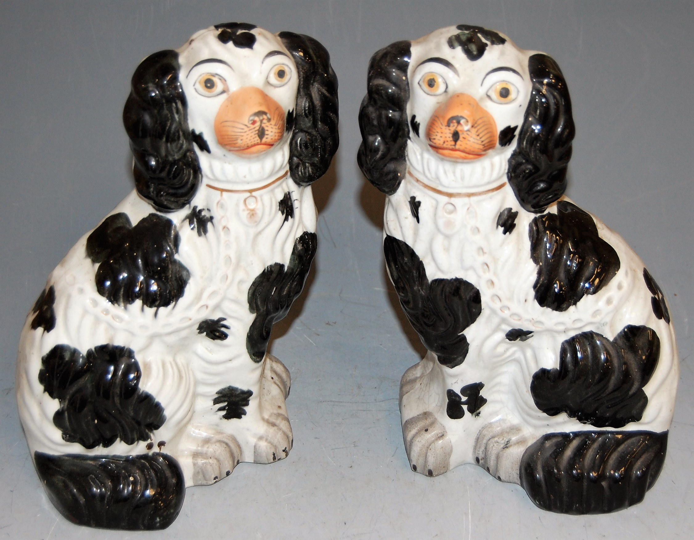 Lot 45 - A pair of Victorian Staffordshire figures of seated spaniels, h.27cm