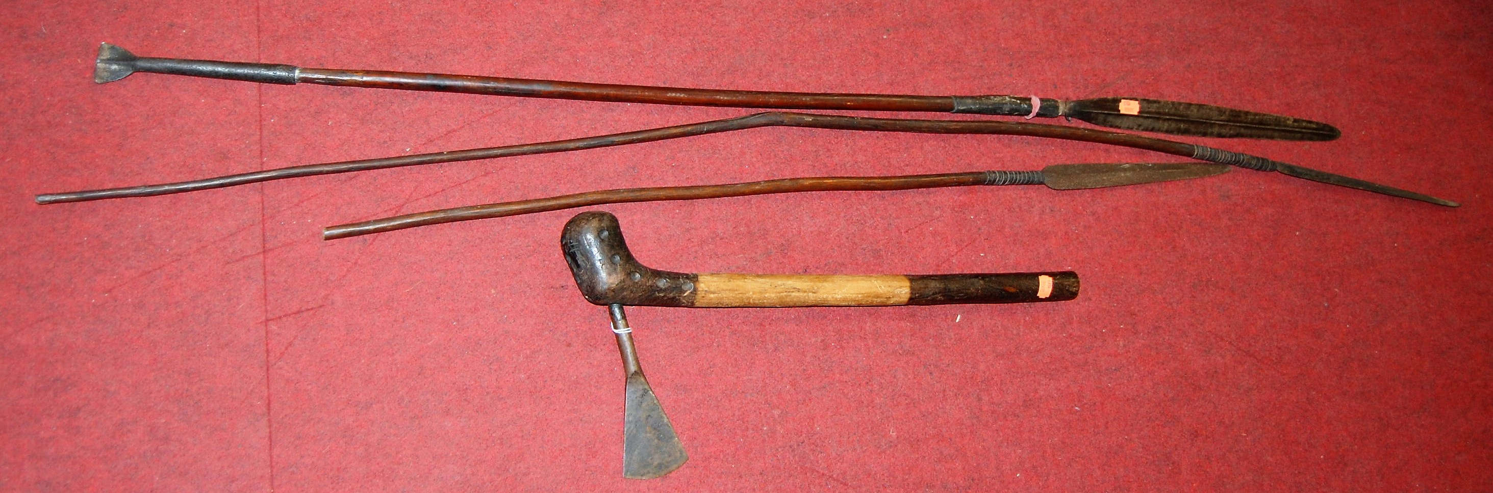 Lot 9 - An early 20th century Shona (Zimbabwe) fighting axe; together with three associated fighting spears