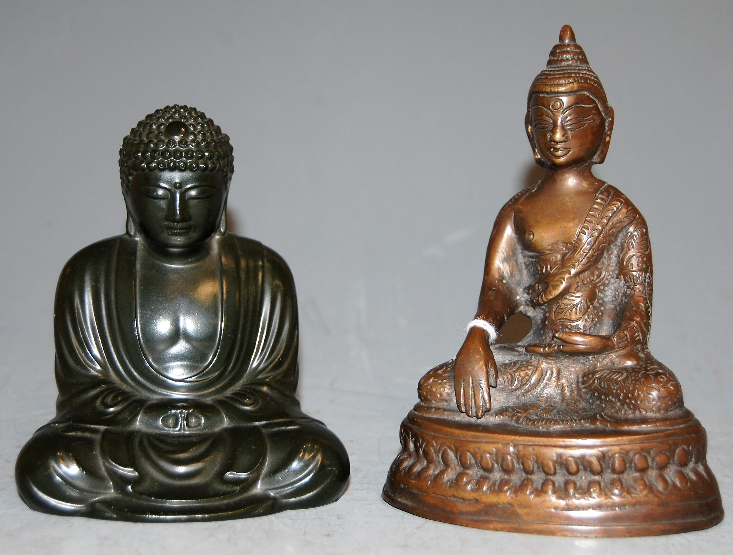 Lot 16 - A Tibetan bronze Buddha in seated lotus pose, h.15cm; together with one other seated Buddha (2)