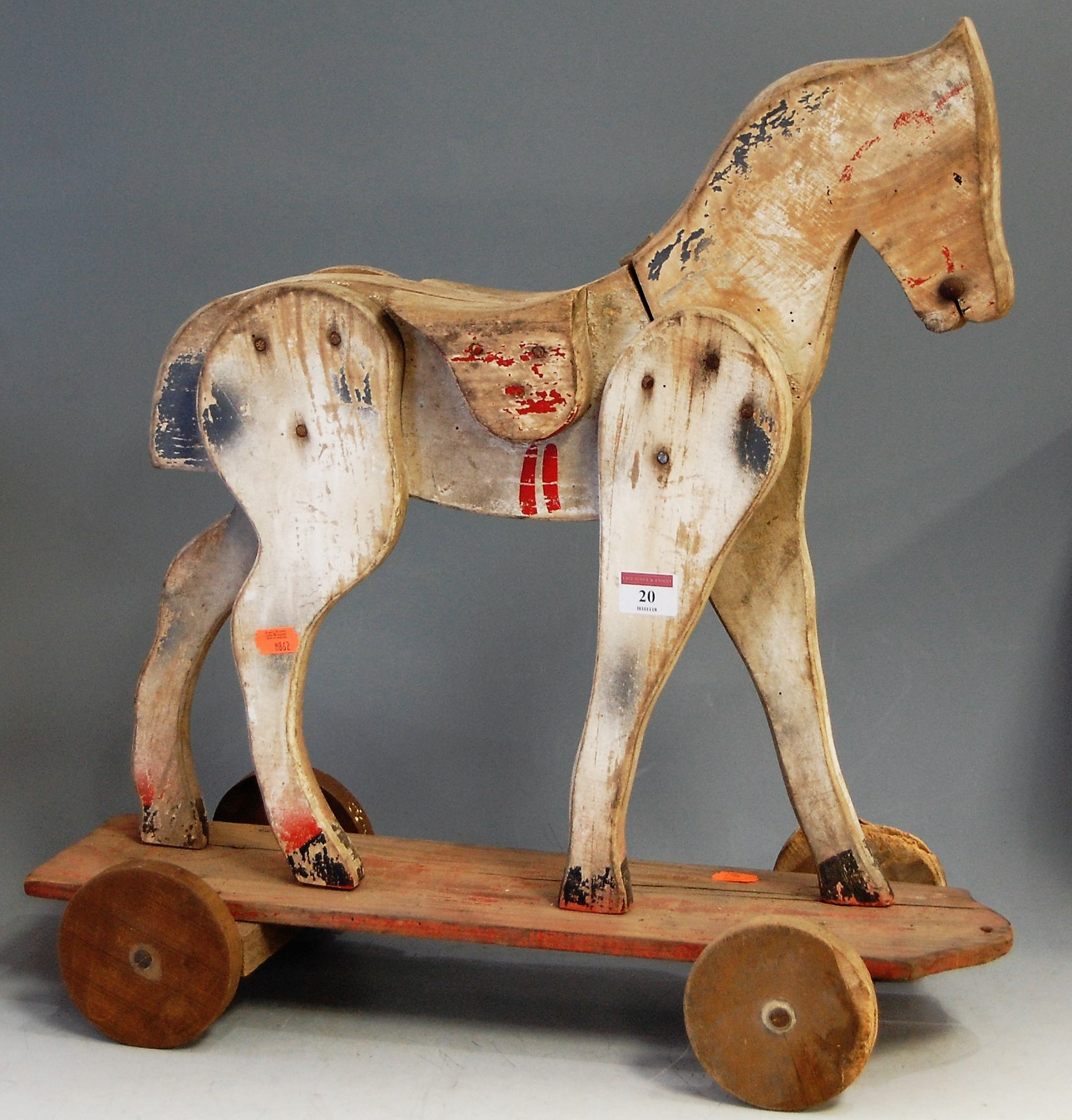 Lot 20 - A mid-20th century childs' painted push-along horse, h.53cm