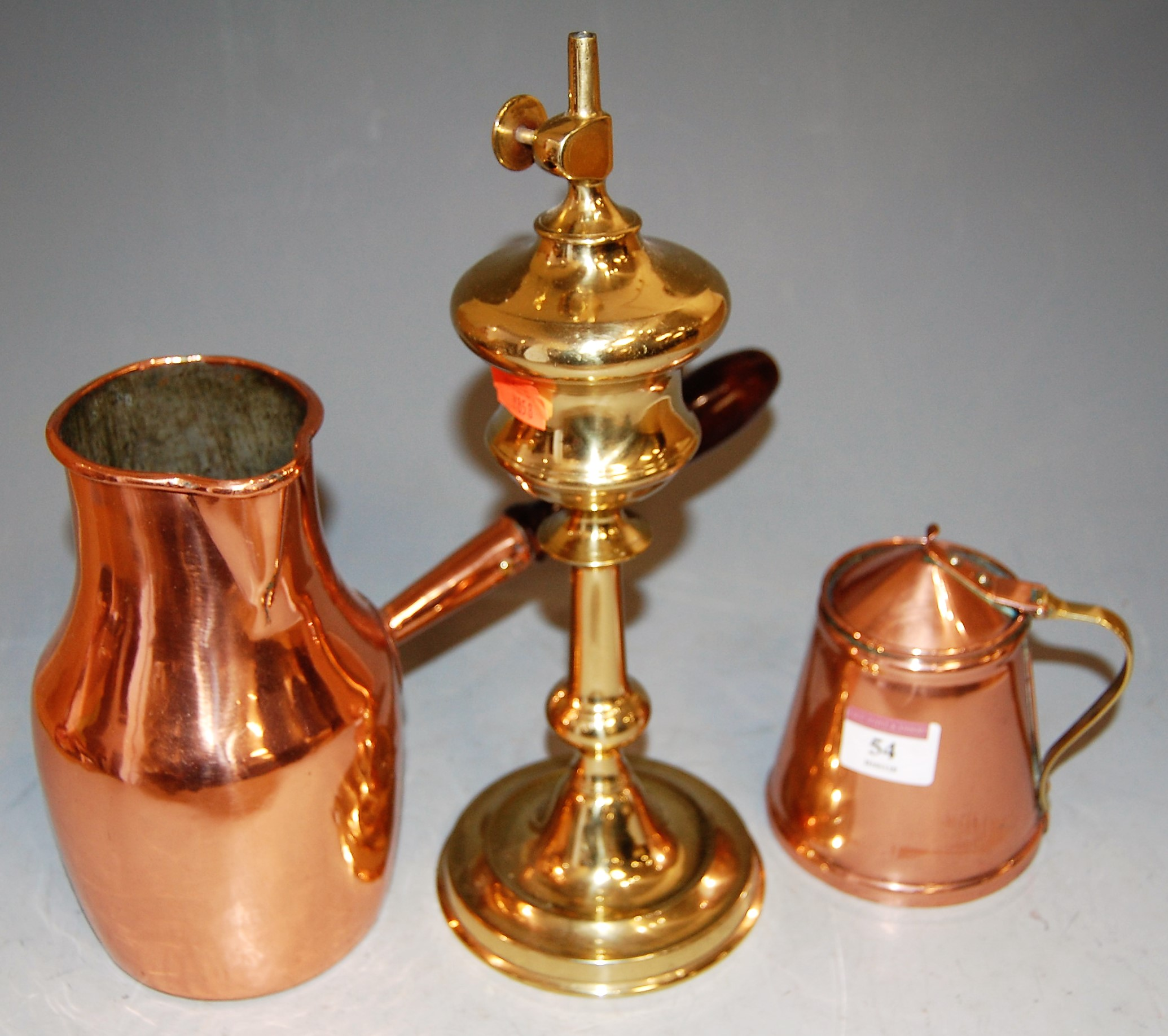 Lot 54 - An early 20th century copper mug, of tapered cylindrical form, having brass handle, stamped verso
