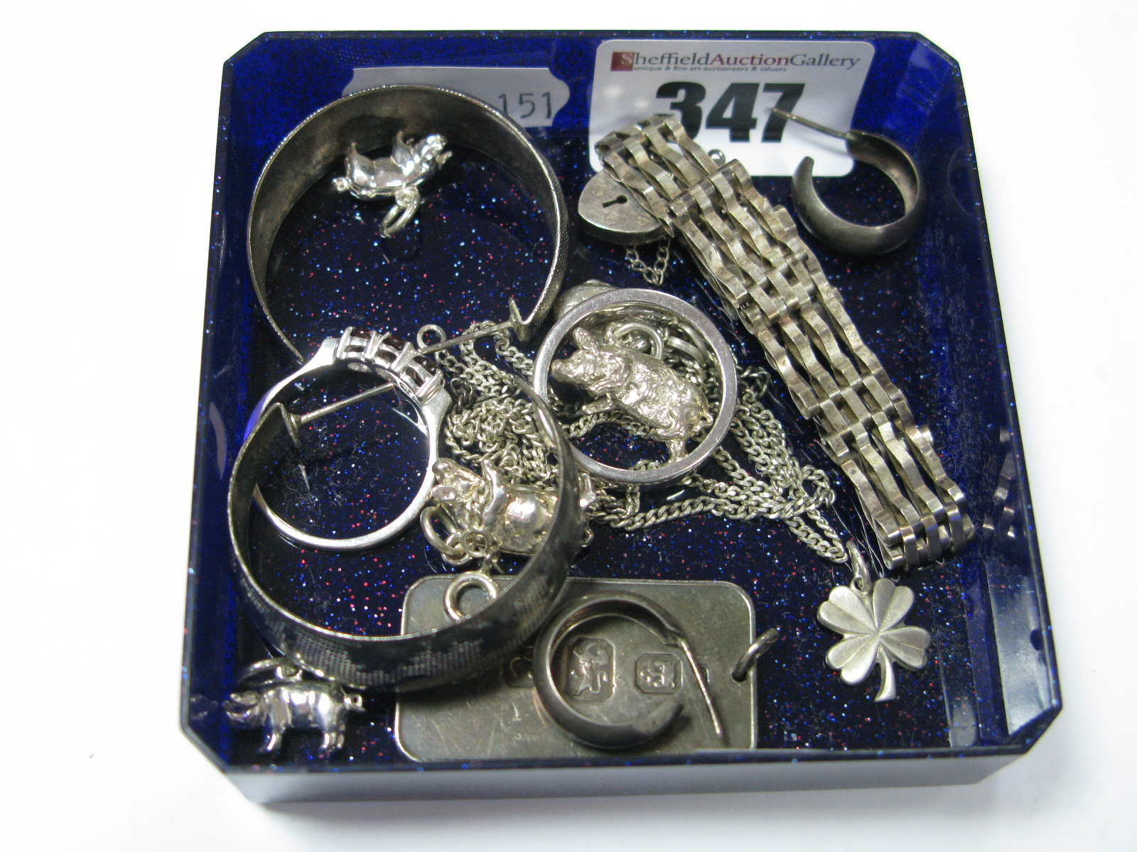 Lot 347 - A Hallmarked Silver Ingot Pendant, a bracelet with heart shape padlock style clasp, novelty charm